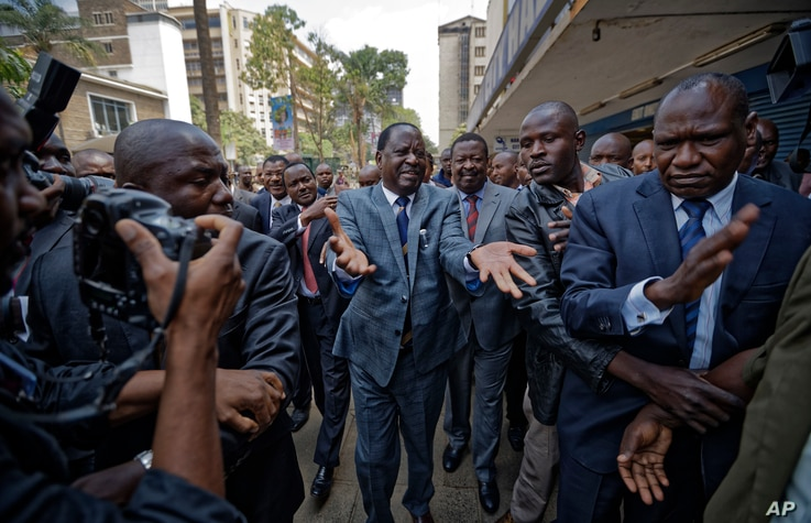 Opposition leader Raila Odinga gestures as he arrives at the Supreme Court in downtown Nairobi, Kenya Friday, Sept. 1, 2017.