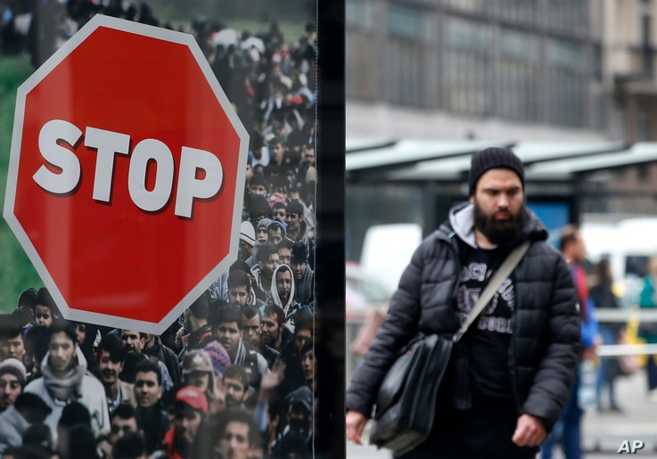 A man walks by an anti-migration billboard from the Hungarian government on a street in Budapest, Hungary, April 7, 2018. Hungarians will vote Sunday in parliamentary elections, with current Prime Minister Viktor Orban running for a third consecutive...