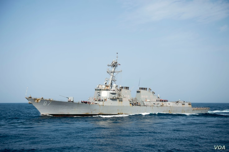 The guided-missile destroyer USS Mason is replenished at sea. The ship responded to an incoming missile threat off Yemen's coast Oct. 12, 2016.
