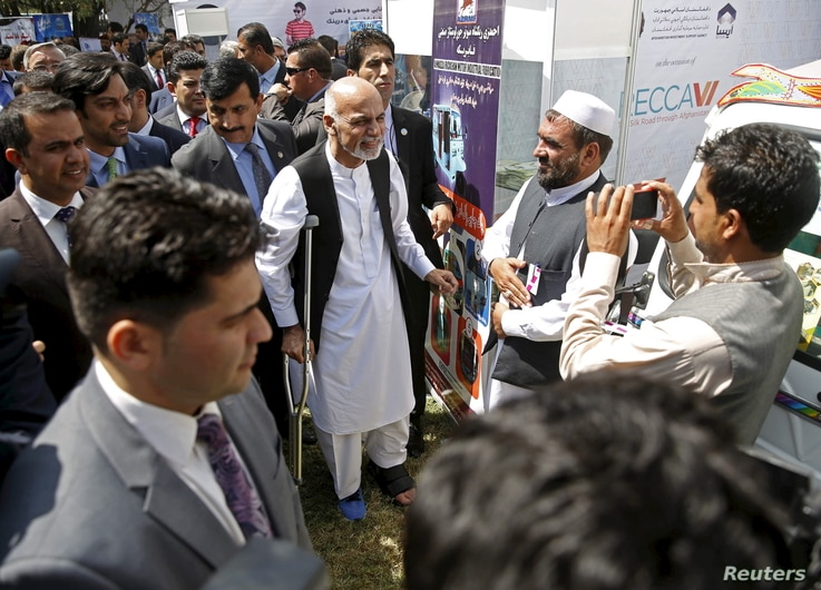 Afghan President Ashraf Ghani, center, talks to participants at an exhibition of Afghanistan products during the Regional Economic Cooperation Conference of Afghanistan (RECCA) in Kabul, Afghanistan, Sept. 4, 2015.