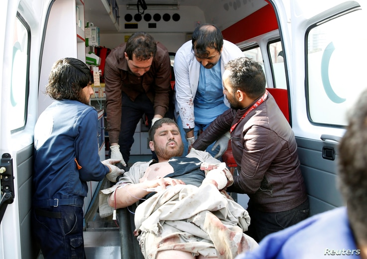 People carry an injured man to a hospital after a blast in Kabul, Afghanistan, Jan. 27, 2018.