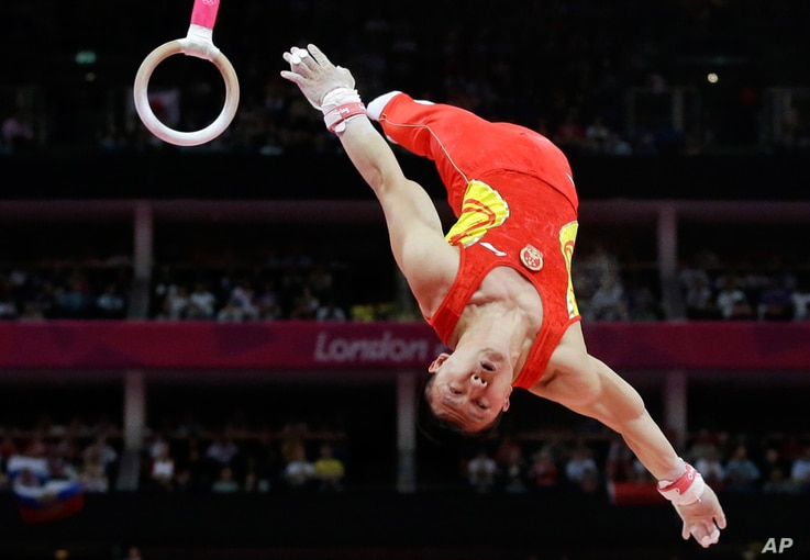 Chinese gymnast Chen Yibing performs on the rings during the Artistic Gymnastic men's team final.
