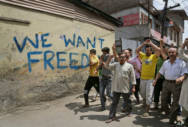 Kashmiri protesters shout pro-freedom slogans during a protest march in Srinagar, Indian controlled Kashmir, Aug. 11, 2016.