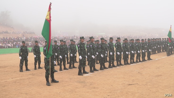 Karen National Liberation Army soldiers stand at attention during the Karen  Revolution day ceremonies Jan. 31, 2019, in Karen state, Myanmar, near the Thai-Myanmar border.