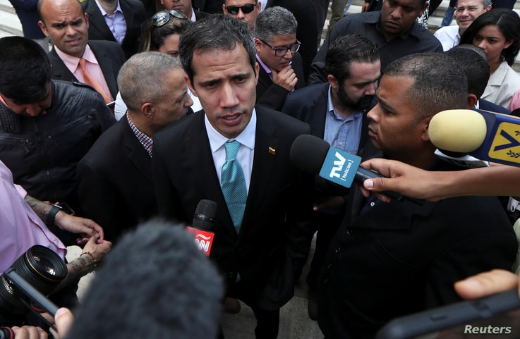 Venezuelan opposition leader Juan Guaido, who many nations have recognized as the country's rightful interim ruler, speaks to the media after a meeting with young leaders at the National Assembly in Caracas, Venezuela, April 4, 2019.