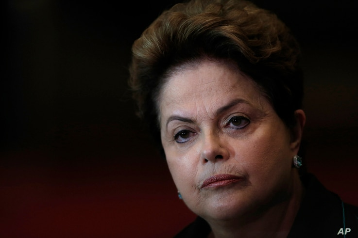 FILE - In this Oct. 6, 2014 file photo, Brazil's President Dilma Rousseff listens to a question during a campaign news conference at the Alvorada Palace, in Brasilia, Brazil.