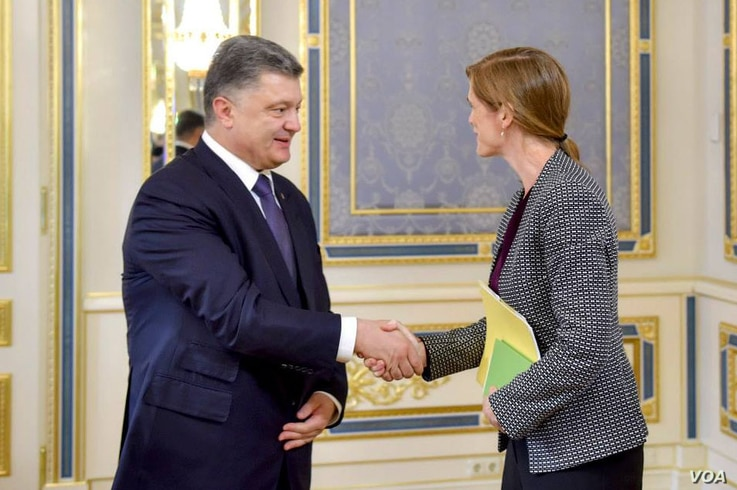 Ukrainian President Petro Poroshenko shakes hands with the United U.N. Ambassador to the United Nations Samantha Power, during their meeting in Kyiv June 10, 2015. (Courtesy - President Poroshenko's personal Facebook page)