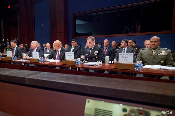 From left, FBI Director James Comey, CIA Director John Brennan, Director of National Intelligence James Clapper, NSA Director Adm. Michael Rodgers, and DIA Director Lt. Gen. Vincent Stewart, appear on Capitol Hill in Washington, Sept. 10, 2015.