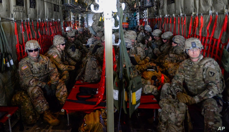 In this photo provided by the U.S. Air Force, soldiers from the the 89th Military Police Brigade, and 41st Engineering Company, 19th Engineering Battalion, Fort Riley, Kan., arrive at Valley International Airport, Nov. 1, 2018, in Harlingen, Texas, t...