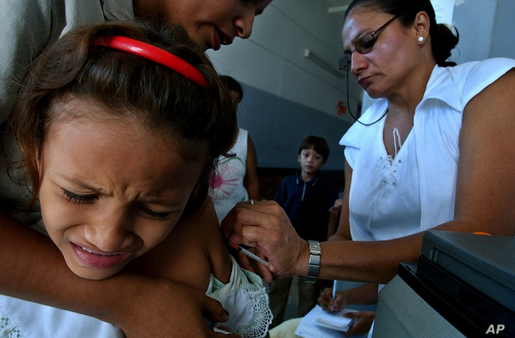 Measles in the Americas: A girl is vaccinated against the Rubeola (Measles), at a Health clinic in Managua, Nicaragua, Wednesday, Nov, 30, 2005.