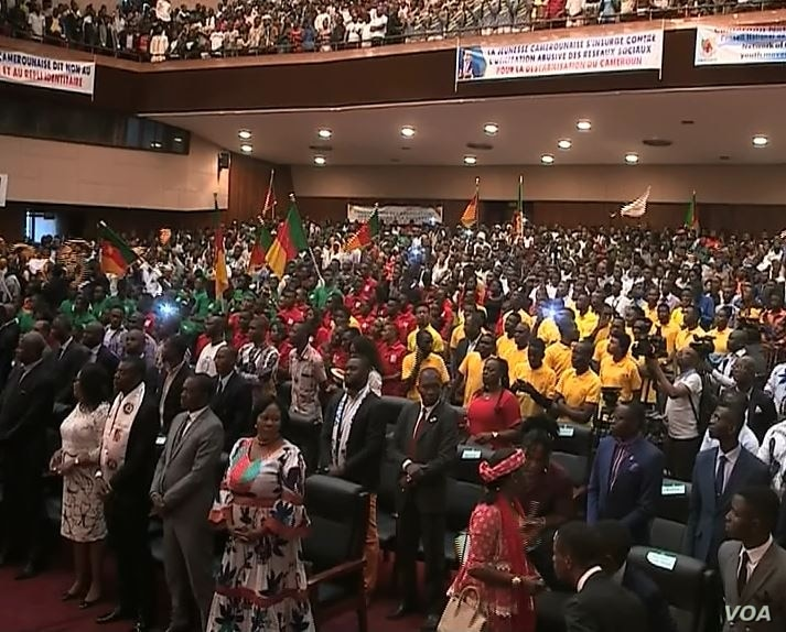 Young supporters, many bussed in from other parts of the country, mark President Paul Biya's birthday, at Yaounde Conference Center, in Yaounde, Cameroon, Feb 13, 2019.