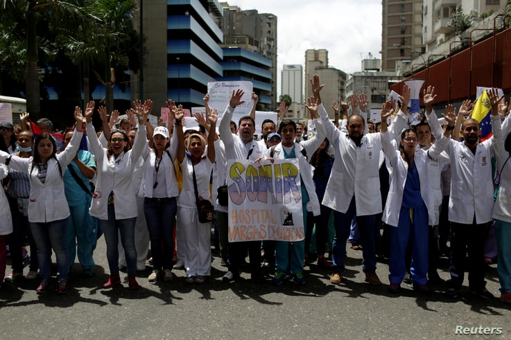 Workers of the health sector and opposition supporters take part in a protest against President Nicolas Maduro's government in Caracas, Venezuela May 17, 2017.