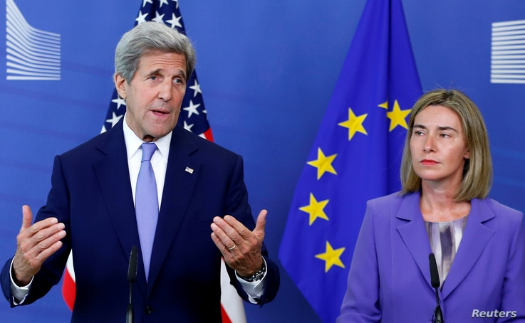 U.S. Secretary of State John Kerry and European Union foreign policy chief Federica Mogherini (R) address a joint news conference after their meeting at the EU Commission headquarters in Brussels, Belgium, June 27, 2016.