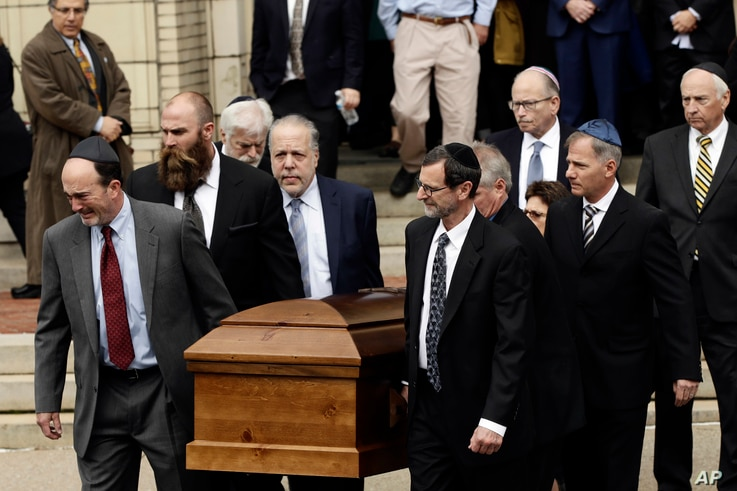 A casket is carried out of Rodef Shalom Congregation after the funeral services for brothers Cecil and David Rosenthal, Oct. 30, 2018, in Pittsburgh. The brothers were killed in the mass shooting Oct. 27 at the Tree of Life synagogue.