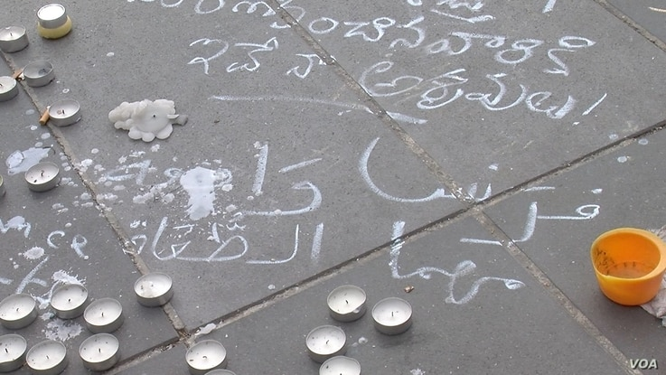 Arabic text written at Place de la Republique expresses solidarity for the victims of last week's Paris attacks, in which 129 people were killed, Paris, Nov. 16, 2015.