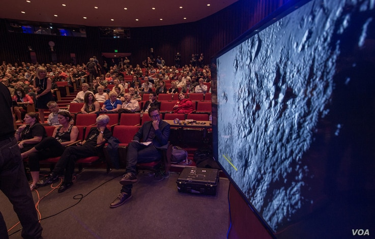 New Horizons media briefing shows some of the first data and images collected since the spacecraft's fly-by of Pluto, at the Johns Hopkins University Applied Physics Laboratory (APL), Laurel, Maryland, July 15, 2015.