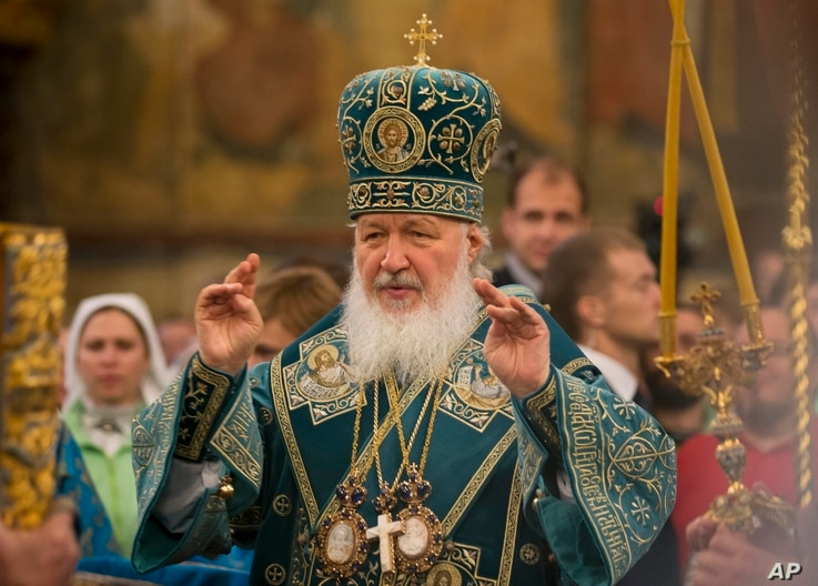 FILE - Russia's Patriarch Kirill officiates at a religious service inside the Cathedral of the Assumption at Cathedral Square in Moscow, Russia, Nov. 4, 2015.