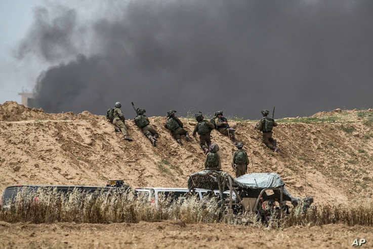 Israeli soldiers are seen during protests along Israel Gaza border, April 20, 2018. Four Palestinians were killed by Israeli troops firing from across the border fence, health officials said.