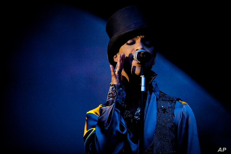 American singer and songwriter Prince performs on the Isle of Amager in Copenhagen, Denmark, Aug. 6, 2011.