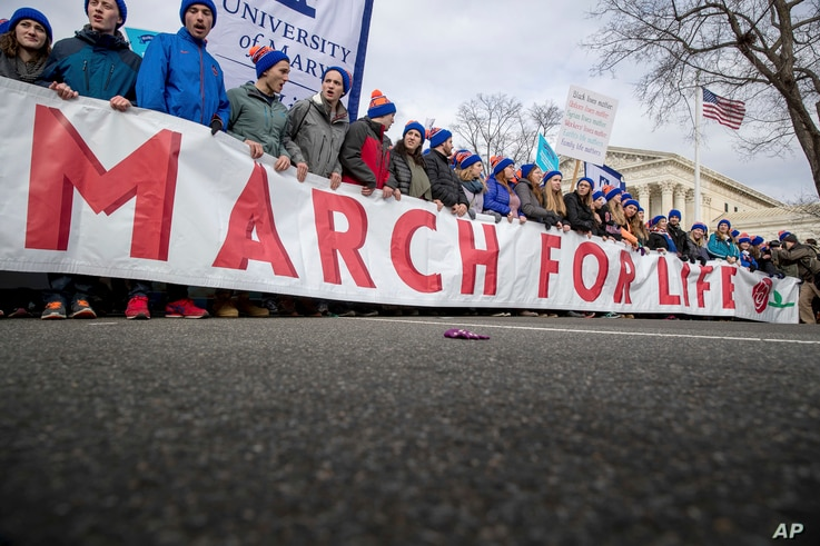 Anti-abortion activists march past the Supreme Court in Washington, Jan. 27, 2017, during the annual March for Life.