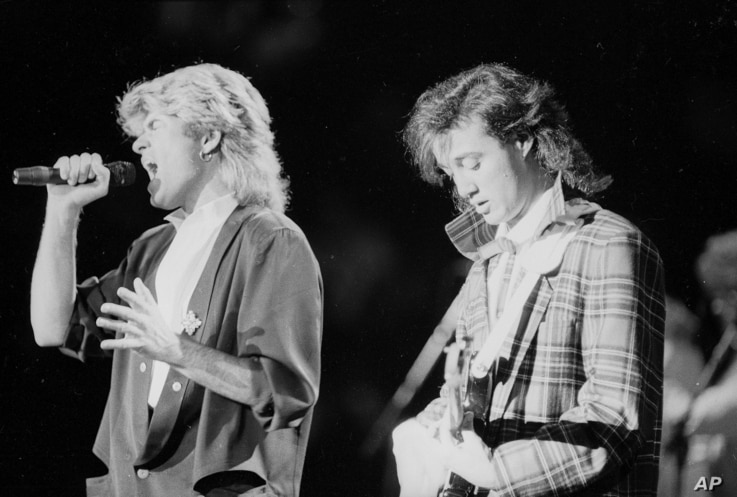 FILE - The pop duo Wham! performs in Peking before a capacity audience of Chinese and foreign fans, April 7, 1985.