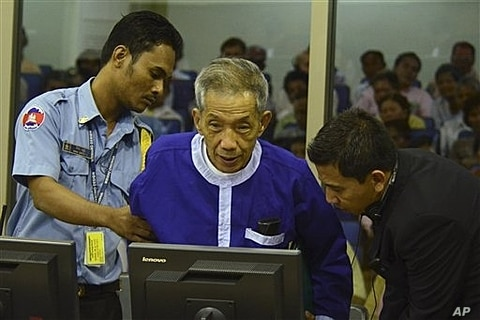 Kaing Guek Eav, alias Duch, who ran a prison where up to 16,000 people were tortured before being killed, before war crimes tribunal, Phnom Penh, Cambodia, March 19, 2012.