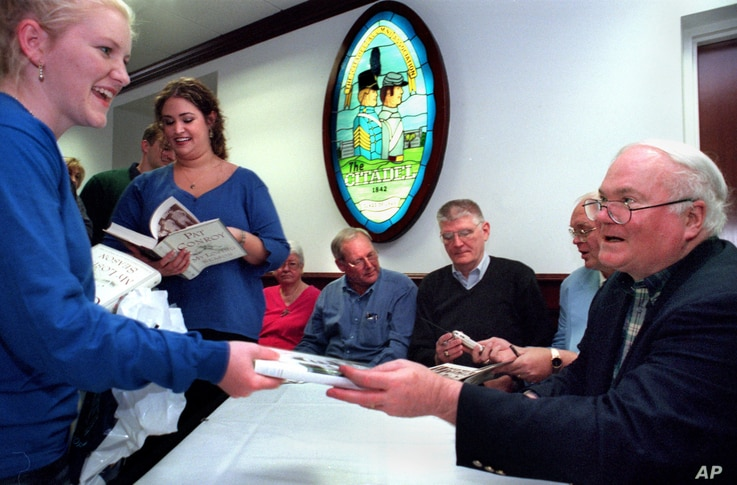 "FILE - Author Pat Conroy receives a copy of his book, ""My Losing Season,"" at a book-signing event at Conroy's alma mater, The Citadel Military College in Charleston, South Carolina, Nov. 8, 2002."