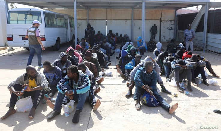 Migrants are seen at a naval base after being rescued by the Libyan coast guard in Tripoli, Libya, March 10, 2018.