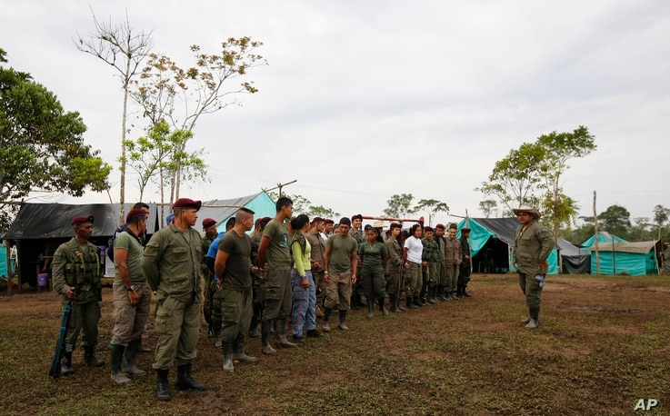 Revolutionary Armed Forces of Colombia (FARC) gather at their camp in La Carmelita near Puerto Asis in Colombia's southwestern state of Putumayo, March 1, 2017, the deadline for  FARC to turn over 30 percent of their arms. But logistical delays setti...