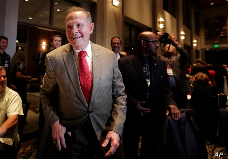 FILE- In this Sept. 26, 2017, photo, former Alabama Chief Justice and U.S. Senate candidate Roy Moore greets supporters before his election party in Montgomery, Alabama.