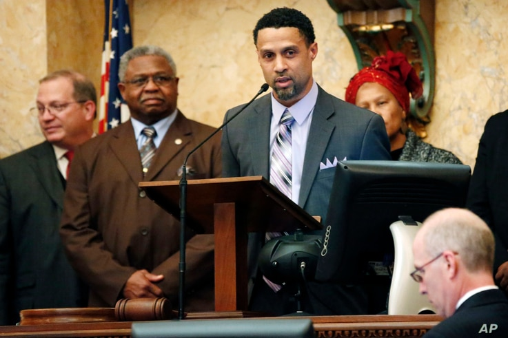 Reps. Jeffrey Guice, R-Ocean Springs, left, and Billy Broomfield, D-Moss Point, second from left, listen as former basketball player Mahmoud Abdul-Rauf expresses his thanks for being honored by the Mississippi House with a resolution noting his athle...