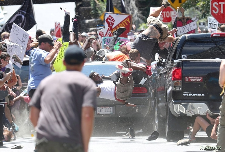 A vehicle plows into a group of protesters marching along 4th Street NE at the Downtown Mall in Charlottesville on the day of the Unite the Right rally, Aug. 12, 2017.