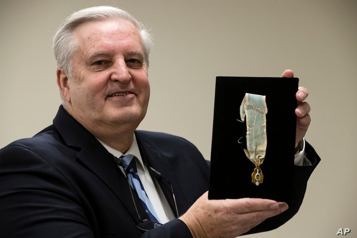 Displayed is Alexander Hamilton's Society of the Cincinnati Eagle insignia by Douglas Hamilton, his fifth great-grandson, at the Museum of the American Revolution in Philadelphia, Nov. 12, 2018.