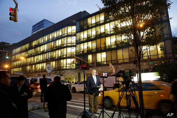 Television news crews work in front of Bellevue Hospital, Friday, Oct. 24, 2014, in New York. Dr. Craig Spencer, a resident of New York City and a member of Doctors Without Borders, was admitted to Bellevue Thursday and has been diagnosed with Ebola....