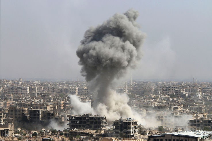 Smoke rises after shelling by the Syrian army, after Russian airstrikes, in Damascus, Syria, Oct. 14, 2015.