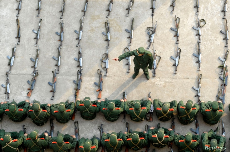 FILE - Paramilitary recruits listen to a briefing during a regular training session at an army base in Nanjing, east China's Jiangsu province.