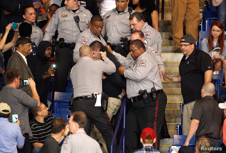 Police officers forcibly restrain a protester at U.S. Republican presidential candidate Donald Trump's campaign rally in Fayetteville, North Carolina, March 9, 2016.