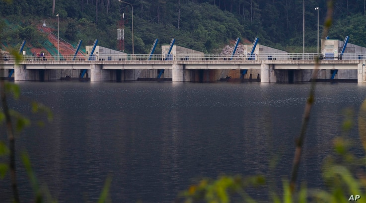 FILE - The Nam Theun 2 dam is seen on the Nam Theun river in central Laos on Oct. 24, 2010.