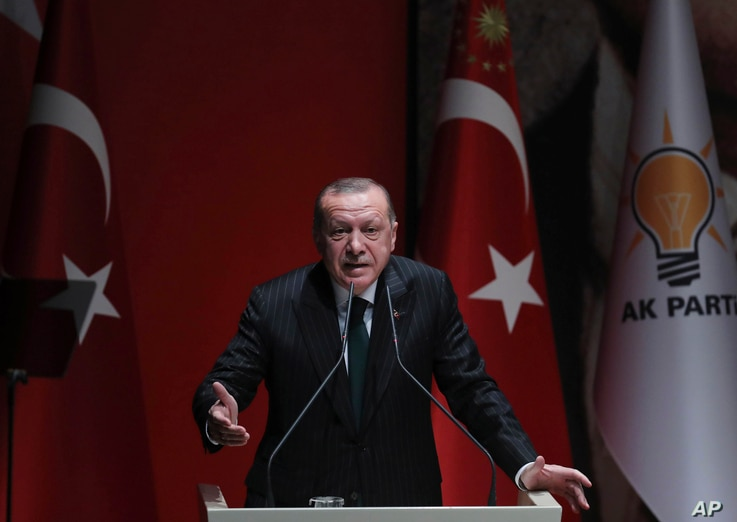 FILE - Turkish President and ruling Justice and Development (AK) Party chair Recep Tayyip Erdogan speaks at a meeting of his party in Ankara, Dec. 6, 2018.