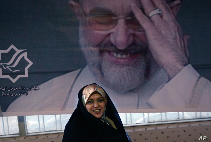 FILE - Sitting under a picture of former Iranian President Mohammad Khatami, Zahra Eshraghi, granddaughter of Ayatollah Ruhollah Khomeini, founder of Iran's 1979 Islamic revolution, looks on in the Youth office of the Coalition of Reformist Groups in...