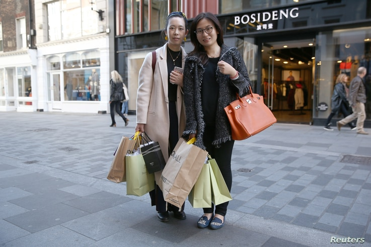 FILE - Chinese tourists Haiti Chen, left, and Jialin Wang pose for a portrait in London, Britain October 5, 2016.