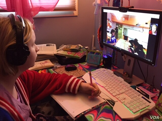 Fifth-grader Cloe Gray, recuperating at her home after surgery, used a home tutor at first but missed the routine of her classes at a Glen Burnie, Maryland, elementary school. Cloe says the robot she now uses gave her the confidence to participate. (...
