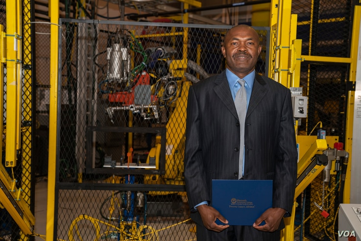 Julius Wakam with his Controls Technician certificate at the Aug. 8, 2018, graduation ceremony at Macomb Community College's M-TEC facility in Warren, Michigan.