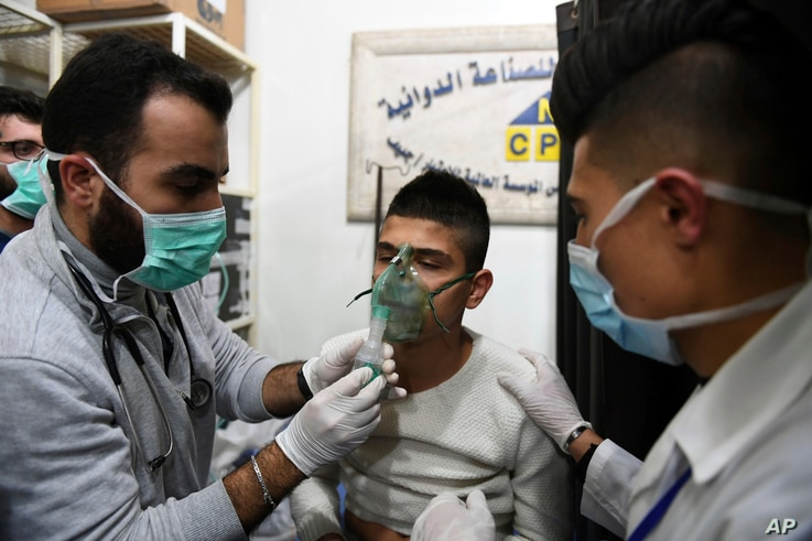 This photo released by the Syrian official news agency SANA shows a man receiving oxygen through respirators following a suspected chemical attack on his town of al-Khalidiya, in Aleppo, Syria, Nov. 24, 2018.
