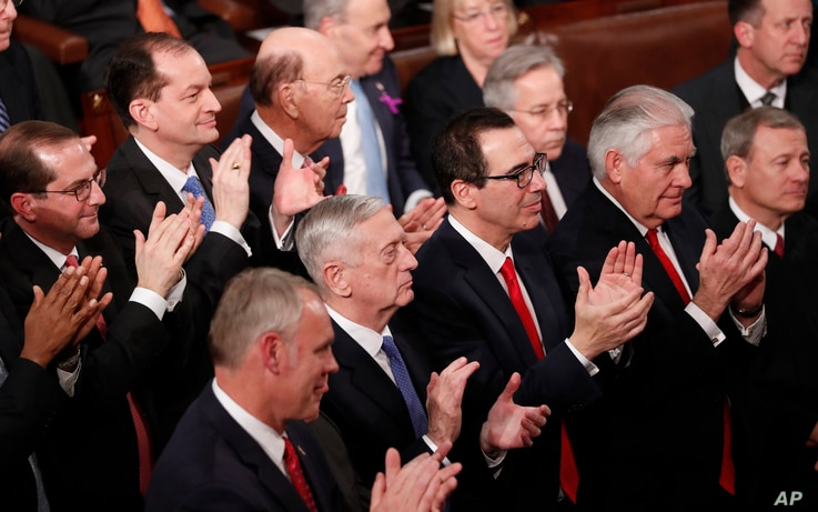 Members of President Donald Trump's Cabinet applaud him as he delivers his State of the Union address to a joint session of the U.S. Congress on Capitol Hill in Washington, Jan. 30, 2018.