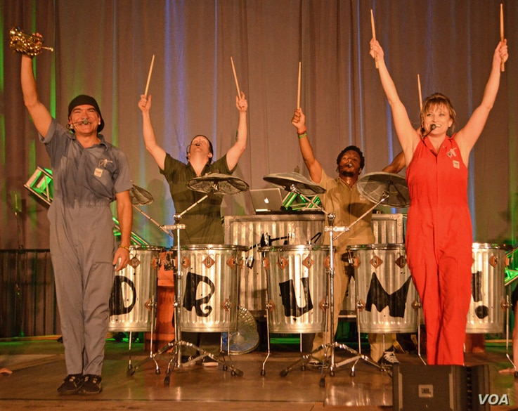 The six members of Vocal Trash spread their reuse and recycle message with every performance. (VOA/S. Logue)