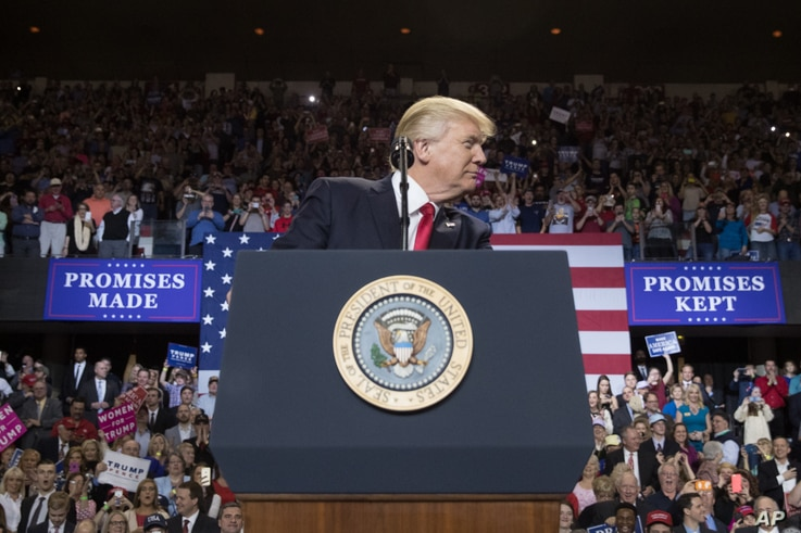 President Donald Trump pauses while speaking at a rally at the Kentucky Exposition Center in Louisville, Kentucky, March 20, 2017.