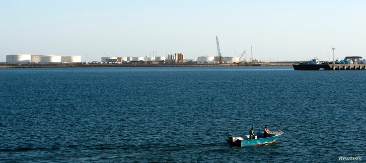 FILE - A speed boat passes by oil docks at the port of Kalantari in the city of Chabahar, 300km (186 miles) east of the Strait of Hormuz, Jan. 17, 2012.