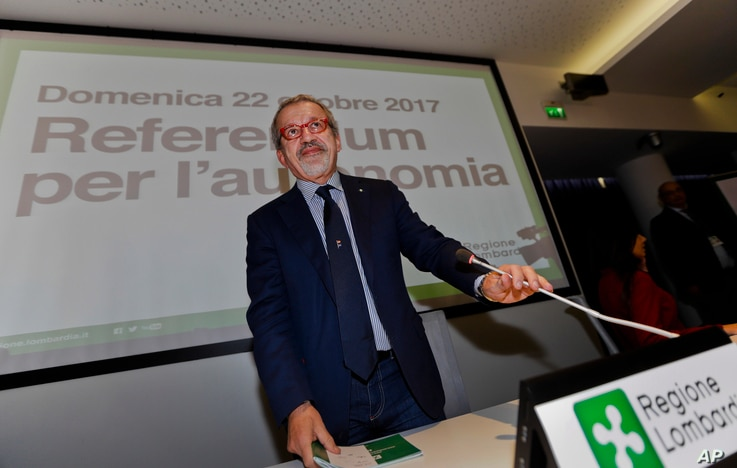 Lombardy Region President Roberto Maroni arrives for a press conference at the Lombardy Region headquarters, in Milan, Italy, Oct. 22, 2017.