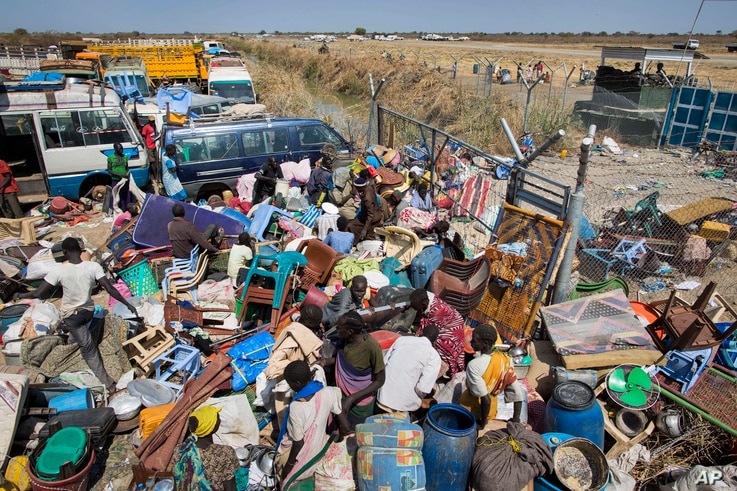FILE - Civilians who fled recent fighting stack their belongings up outside the gate of the United Nations Mission compound in South Sudan (UNMISS), hoping to benefit from their protection, Unity State, South Sudan, Jan 12, 2014.